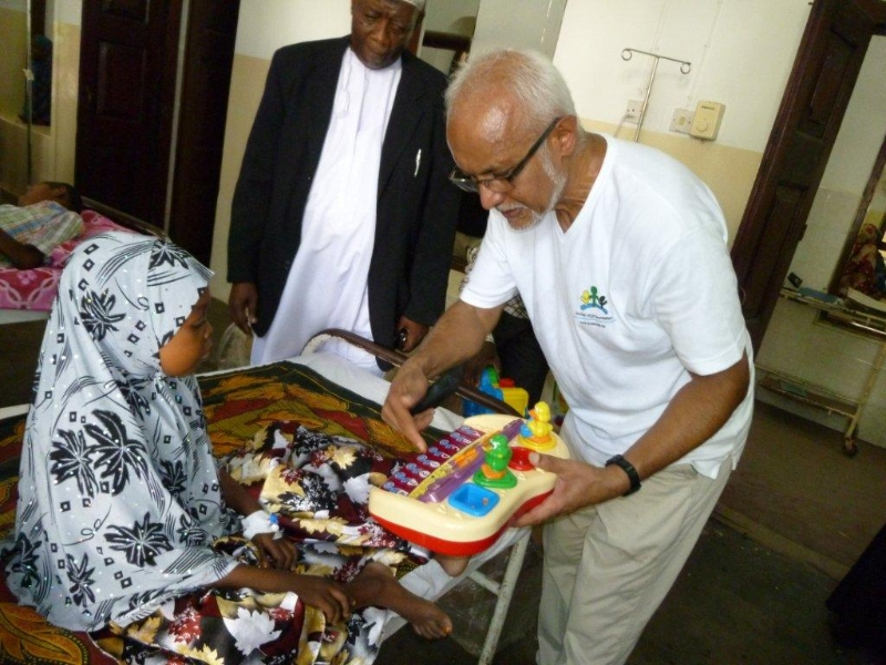 Distributing toys to children at a hospital